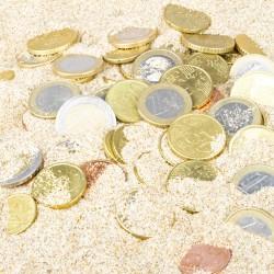 Geld im Sand